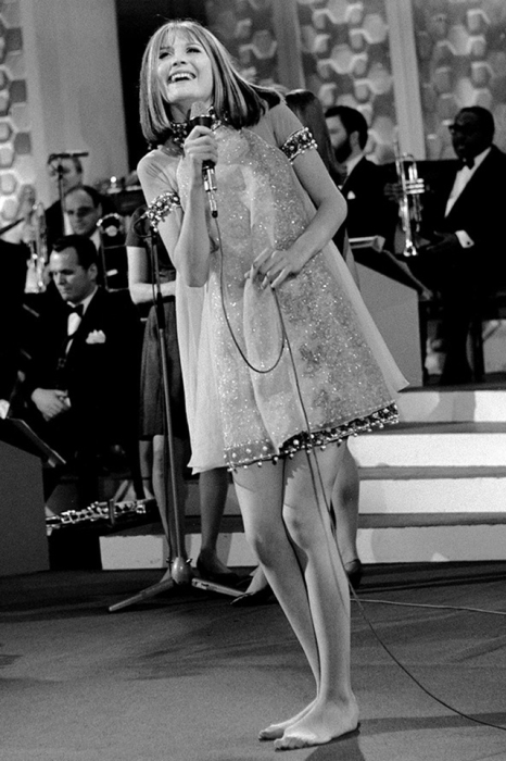 Британская певица, победительница конкурса песни Евровидение 1967 года.