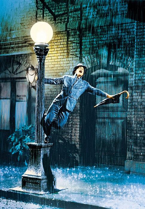 Кадр из фильма «Поющие под дождём» 1952 года выпуска.