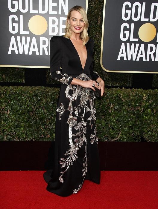 Звездная блондинка в элегантном приталенном платье с вышивкой из бисера от Gucci. /Фото: m.bloglikes.com