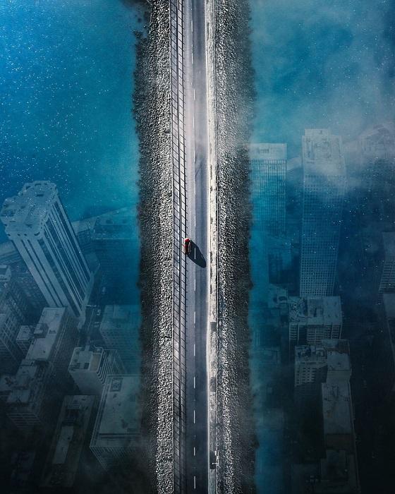 Картинка из ночных кошмаров – узкая лента дороги, проходящая над затопленным величественным мегаполисом прошлого.