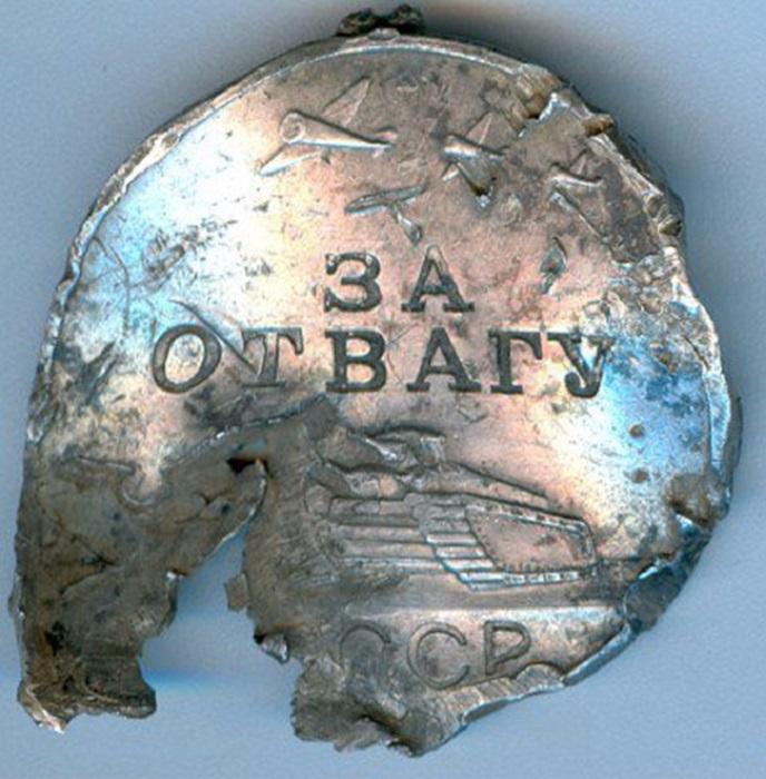 Медаль за уничтожение огневой точки противника.