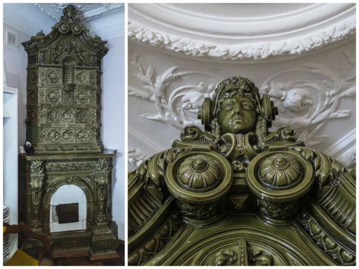 Изразцовый камин финляндского завода «АБО» с навершием в виде женской головы.