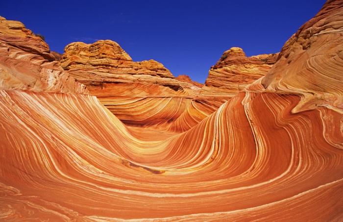 Одно из самых красивых чудес природы на нашей планете, красно-оранжевый цвет из-за обильного количества окиси железа.