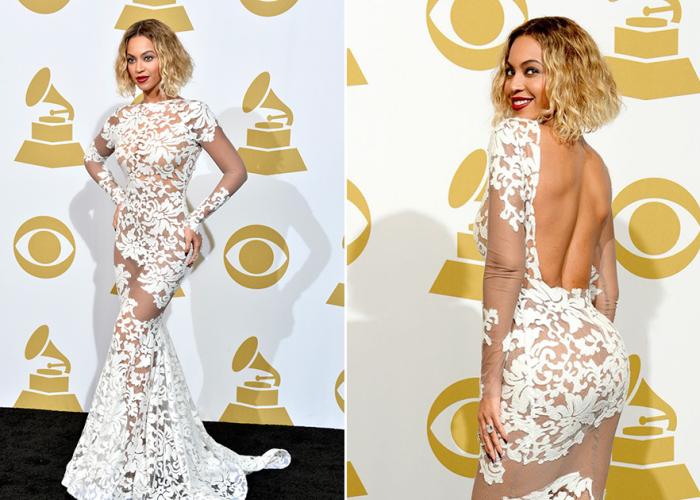 Американская дива в полупрозрачном белом платье с вставками под кружева и открытой спиной.