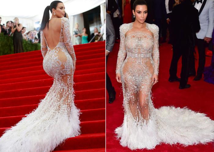 На балу Института костюма Ким позировала в смелом белом прозрачном платье с богатой вышивкой, шлейфом и открытой спиной.