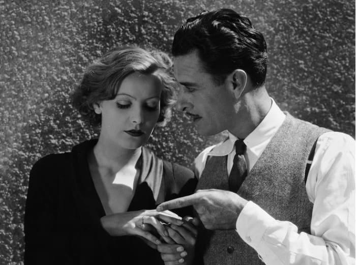 Грета Гарбо и Джон Гилберт на съемках фильма *Плоть и дьявол*, 1926 | Фото: marieclaire.ru