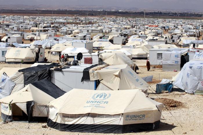 Лагерь беженцев Заатари на севере Иордании, недалеко от границы с Сирией, дающий временное убежище и кров 100 тысячам сирийских беженцев.
