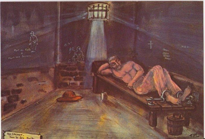 Заключенный в одиночной камере, закованный в кандалы, Французская Гвиана. | Фото: avisa11.skyrock.com.