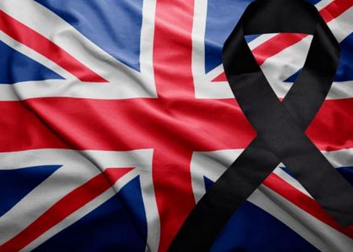 Флаг Великобритании с черной траурной лентой./ Фото: censor.net.ua