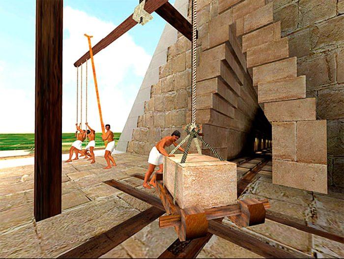 Alavancas de madeira montadas nas bordas da pirâmide poderiam ser usadas para elevar os blocos até o próximo nível.  Reconstrução  / Foto: www.egyptopedia.info