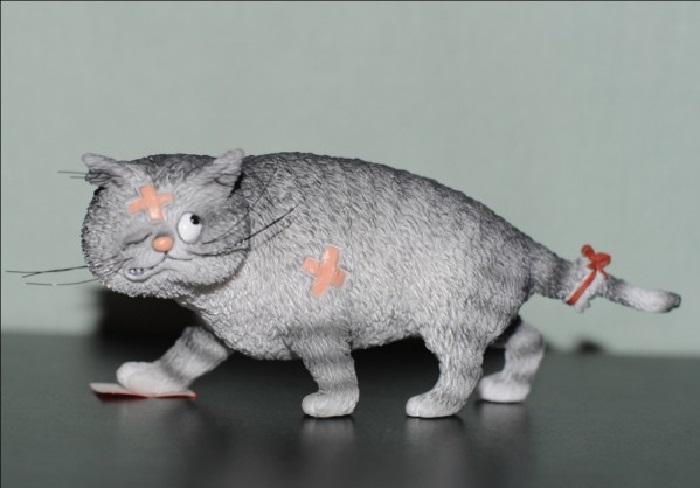 Сувенирные статуэтки из серии *Кошки*. Автор: Альберт Дюбуа.