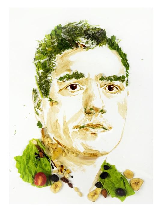 Испанский лидер Педро Санчез из листьев салата и оливок.