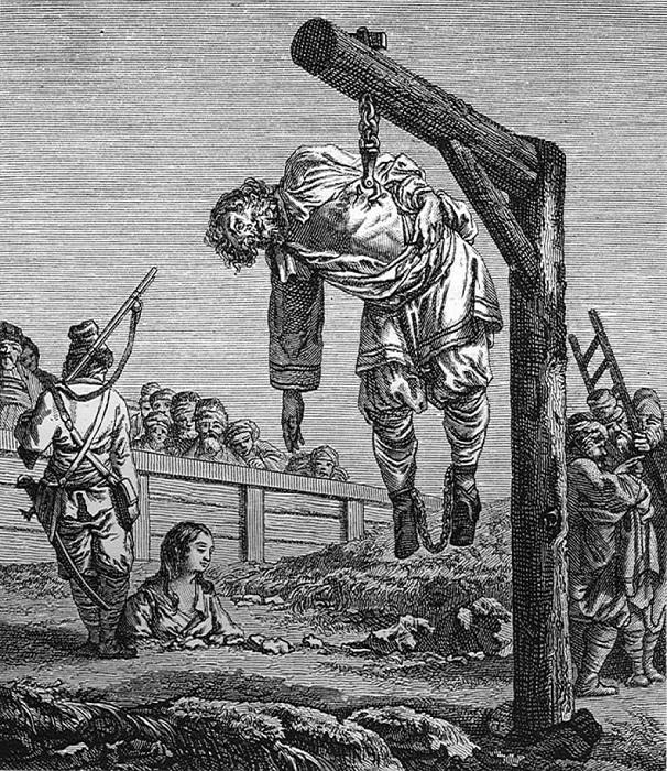 Стрелец охраняет медленно умирающих женщину и мужчину, приговорённых к разным видам казни.