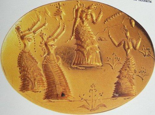 Золотая печатка с изображением танцовщиц.