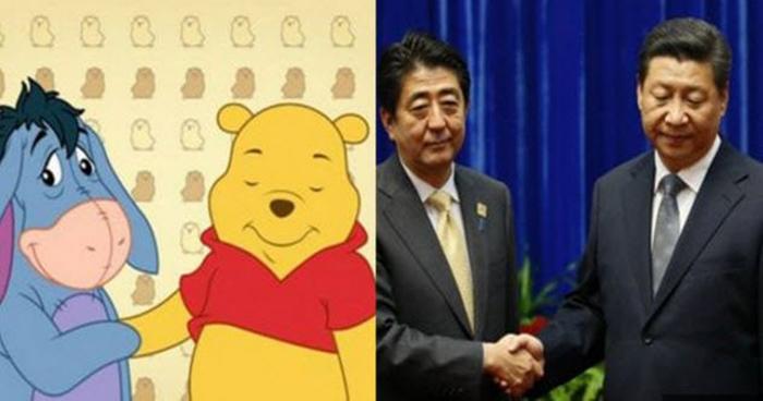 На фото глава Китая Си Цзиньпин жмет руку японскому премьер-министру Синдзо Абэ