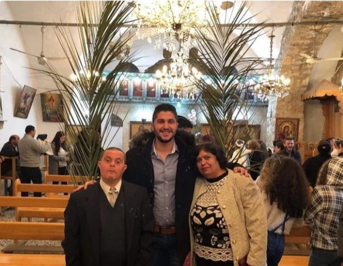 Семья Исса в местной церкви