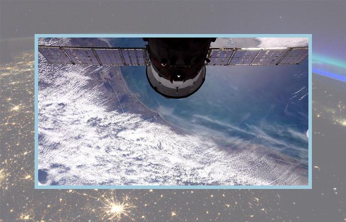 Фото: облака над Хьюстоном, космонавт Роскосмоса Сергей Рыжиков.