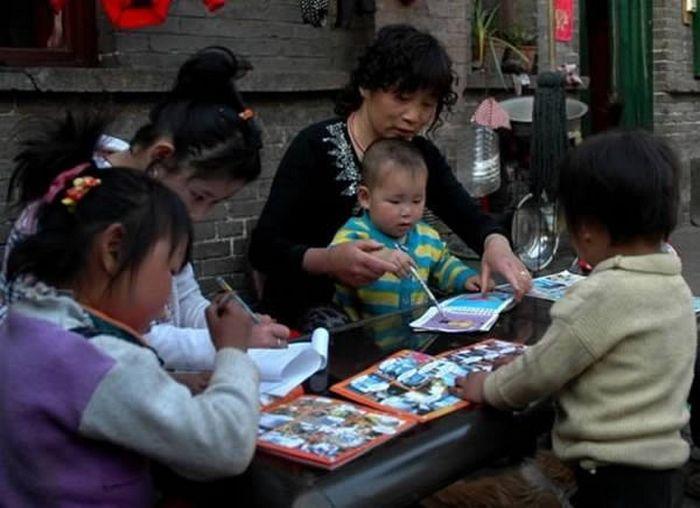 Китайская Мать Тереза, которая отказалась от собственного сына, чтобы усыновить ребенка-инвалида.