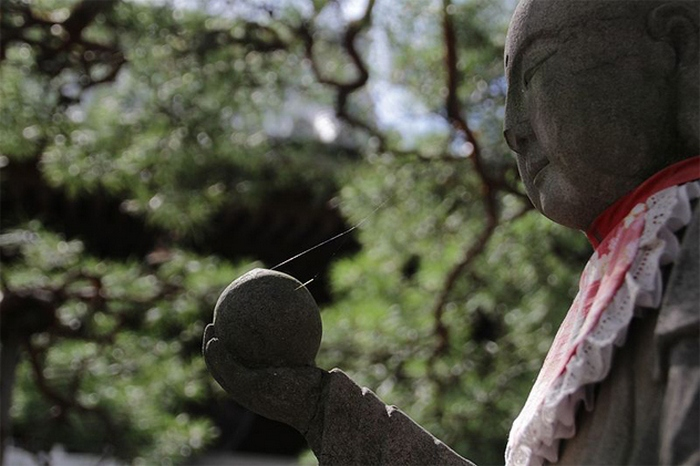 Реплика статуи Будды из храма Дзэнкодзи.