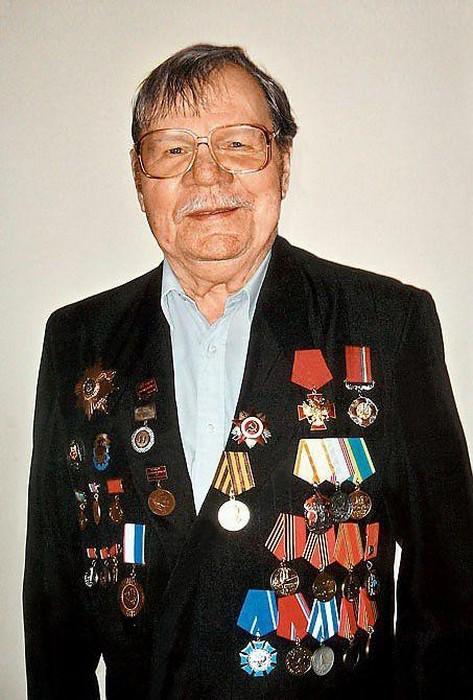 Михаил Иванович Пуговкин.