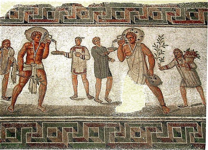 Римская мозаика из Дугги, Тунис (II век н.э.): два раба, несущие винные кувшины, в типичной одежде невольников и с амулетами против сглаза.