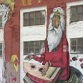 Бразильские граффитисты расписывают здания в Минске